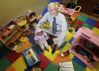 Dr. Robert Nolan, executive director of Miami-Dade's Institute for Child and Family Health,  is surrounded by toys he uses in his work with children.